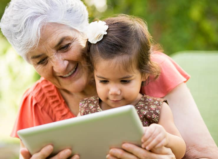Duke Clinical Research Institute Grandma Granddaughter Looking at Tablet