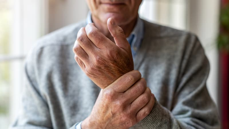 Senior man experiencing arthritis pain in cold weather