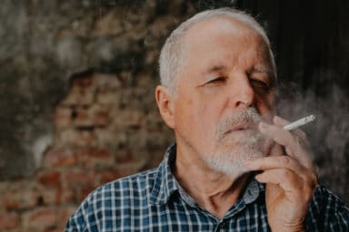 Senior man realizing quitting smoking for seniors is hard