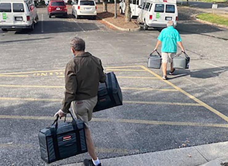 CVACL Man Carrying Totes of Food