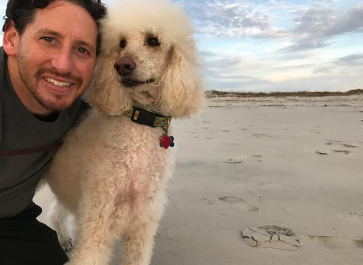 Wrightsville Beach Physical Therapy Dr Weisler with dog on the beach