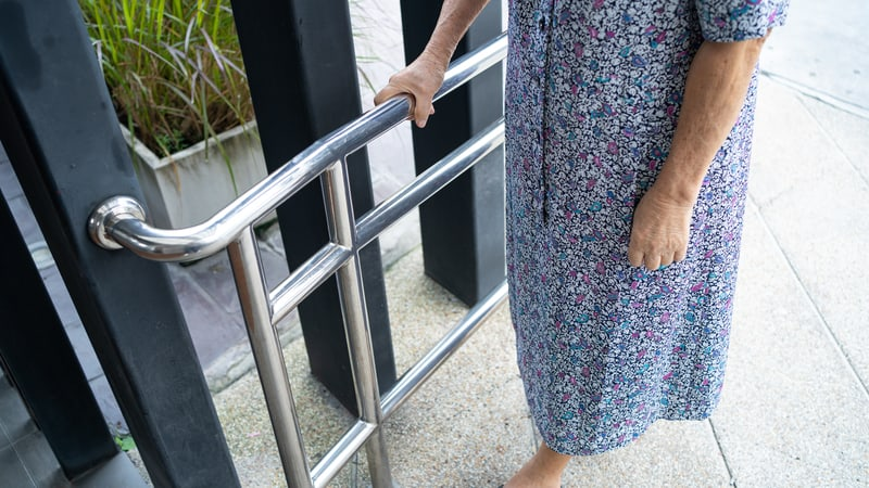 Senior woman using one of the best aging in place products, a grab bar