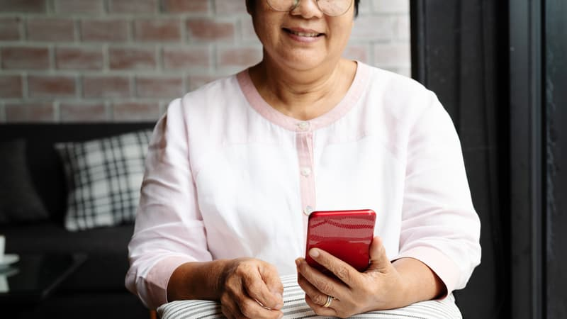 Woman using one of the best cell phones for seniors