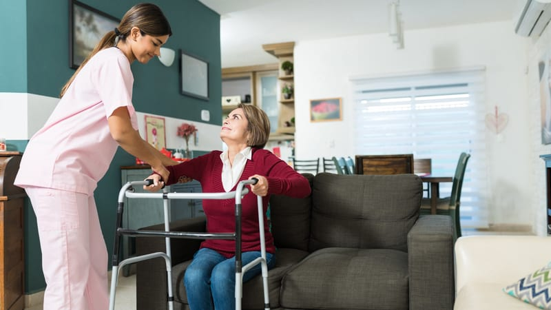 Nurse and resident at a personal care community, sometimes called personal care homes
