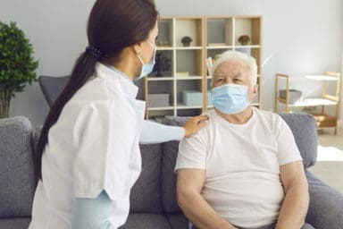 Nurse explaining that senior living is still safe