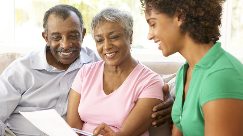 Senior couple meeting with Senior Living Placement Specialist