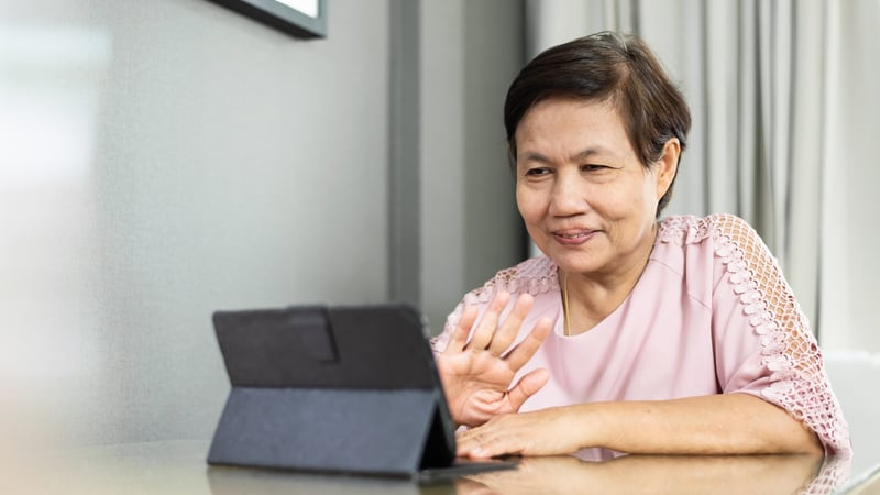 Woman using one of the best video chat apps for seniors