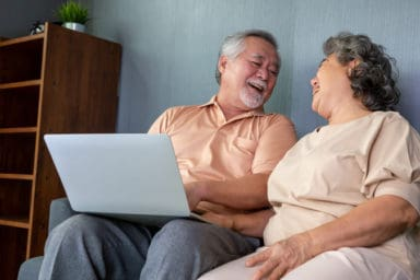 Senior couple playing the best Zoom games for older adults