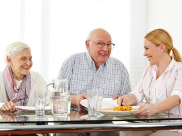 Bethesda Family Care Home Senior Couple with Caregiver