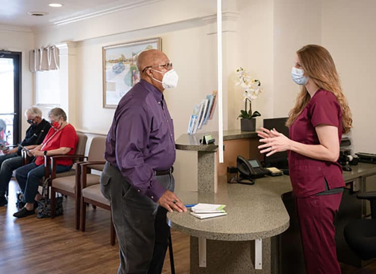 Friendship Physician Clinic Masked Patient in Lobby