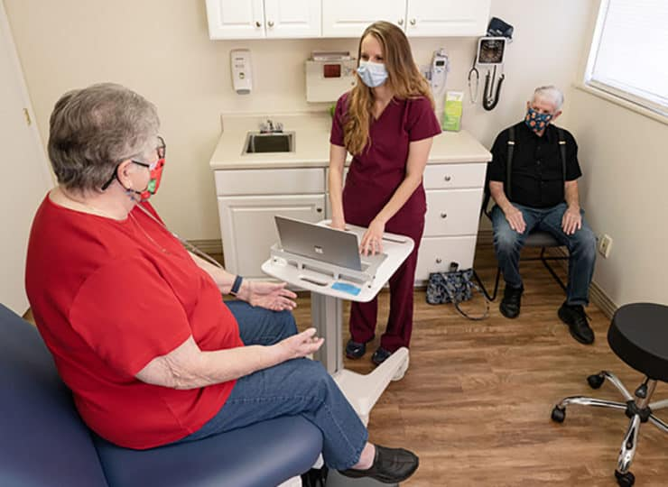Friendship Physician Clinic Masked Resident with Nurse