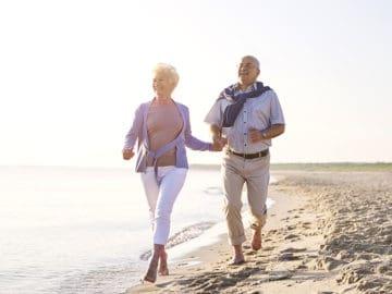 Intracoastal Realty Couple Walking on Beach