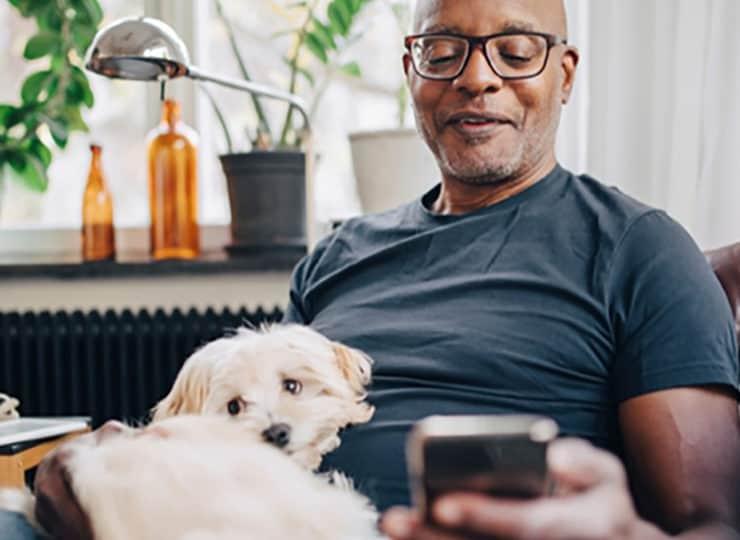 Optima- Health Roanoke Man Looking at Phone