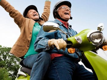 Optima Health Roanoke Senior Couple Riding Scooter