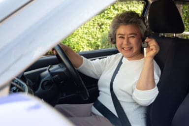 Senior woman buying a car in retirement