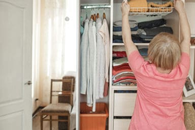 Senior woman working to declutter before listing her home