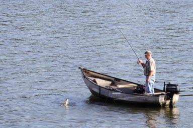 Senior man enjoying some fishing after a stroke