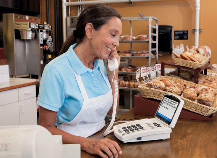 Virginia Relay Lady Using Phone at Bakery