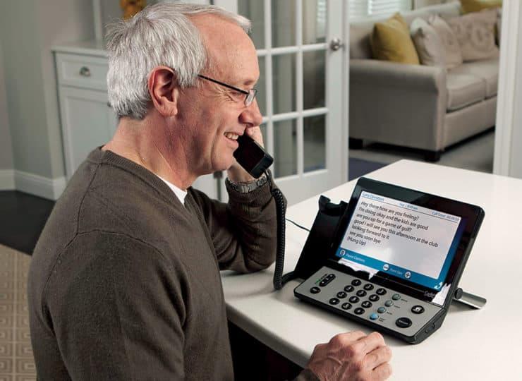Virginia Relay Senior Man Using Phone