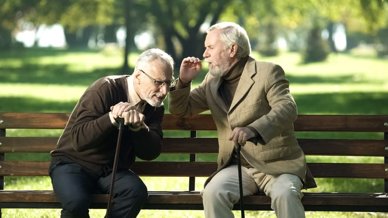 These two seniors are exhibiting Signs It's Time to See an Audiologist