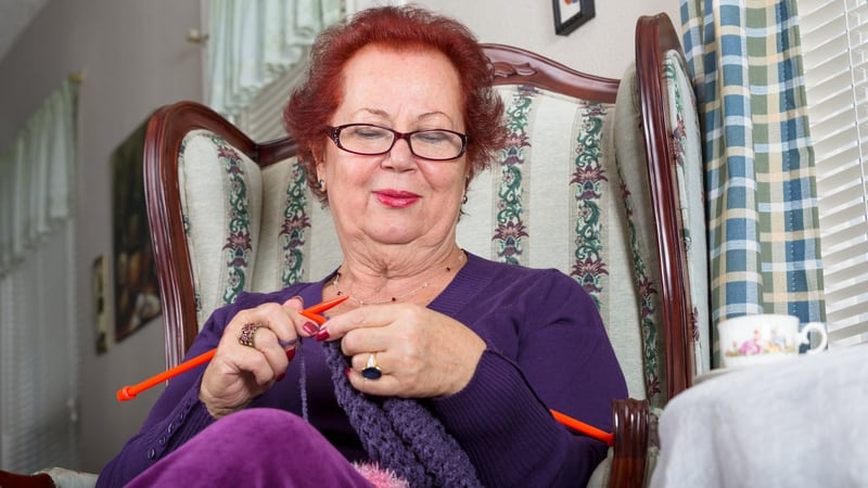 Woman knitting as a way to volunteer from home