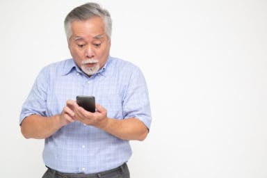 Senior man using his apps to help find lost things