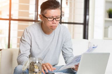 Senior man figuring out how to maximize social security benefits