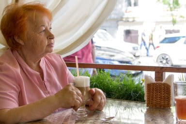 Elderly woman at a dementia village